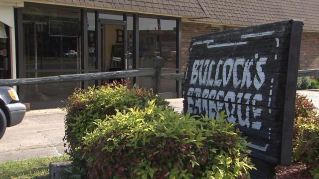Firefighters on Wednesday morning worked to put out a fire at Bullock's Barbecue in Durham.