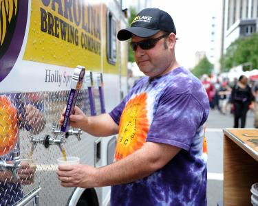 Joe Zonin of Carolina Brewing Company pours a beer. Visitors enjoyed food trucks, local beer and crafts at Brewgaloo 2016, which took place in Raleigh on Saturday, April 23, 2016.