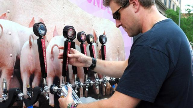 TJ Wagner pours a beer at Brewgaloo 2016, which took place in Raleigh on Saturday, April 23, 2016.