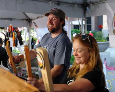 Bryan McCutchen and Michelle Acheson handle the taps. Visitors enjoyed food trucks, local beer and crafts at Brewgaloo 2016, which took place in Raleigh on Saturday, April 23, 2016.