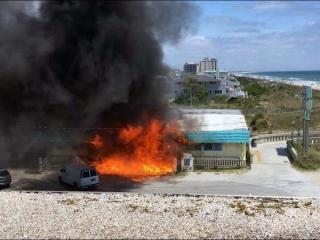 Emergency crews were working Friday afternoon to extinguish a fire at a retail shop in Wrightsville Beach. (Photo courtesy WECT)