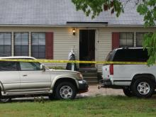 A Wake County sheriff's deputy was injured while trying to serve a warrant Tuesday morning at a home on Old Watkins Road.
