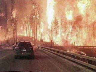 A Raleigh woman says she feels a heaviness and helplessness when she looks at the inferno in the city where she grew up.
