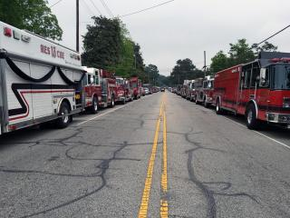 Hundreds of mourners gathered at Kenly Funeral Home Thursday morning to remember John Morris Davis Jr., a volunteer firefighter who died Saturday night when he suffered a heart attack while responding to a call.