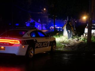 Durham police on Tuesday morning were investigating a shooting on North Elizabeth Street that caused a car to crash into a utility pole.