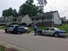Police investigate the death of a 2-year-old boy in a home on Somerset Mill Lane in Raleigh on May 20, 2016.