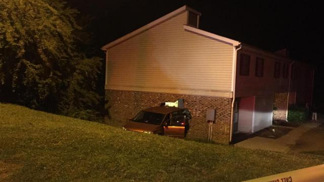 The minivan backed into the side of a townhouse at 1174 Clanton Street and broke through the wall and into the living room of the home just after 10 p.m.