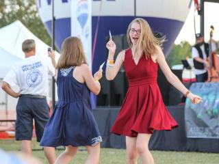 Thousands gather in Fleming Loop Park in Fuquay-Varina, N.C. on Friday, May 27th for the 2016 WRAL Freedom Balloon Festival. The festival included live music, food, games, rides in addition to 35 beautiful hot air balloons. (Photo By: Lexi Baird / WRAL.com)