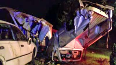 Two people were injured when a pickup flipped and crashed in Clayton.