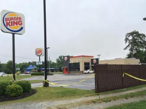 Clinton police shot a man Saturday night in a Burger King parking lot after he pointed a shotgun at officers, Jay Tilley, Clinton Chief of Police said.