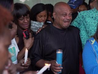 A vigil was held Wednesday night to remember a mother killed in a crash on Memorial Day and share prayers for the man charged in connection with the wreck.