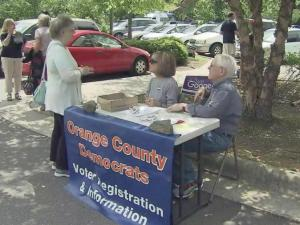 A man who told Orange County voters that he was with the U.S. Department of Justice drew the attention of the federal government after volunteers reported the alleged impersonator to authorities.