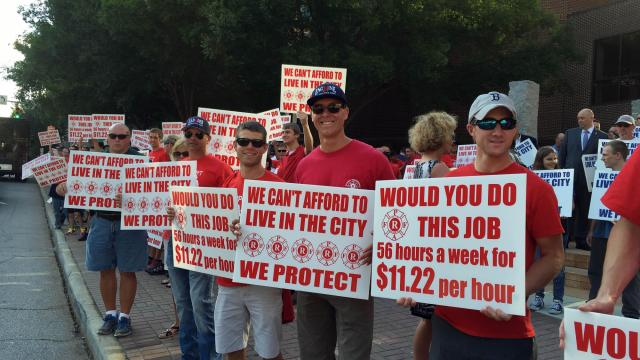 Raleigh firefighters and their supporters rally for 7 percent raises before a June 7, 2016, public hearing on the city's proposed 2016-17 budget.