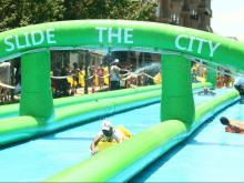 Sliders beat the heat at Slide the City in Downtown Raleigh on Saturday.   Photos by Jerome Carpenter.