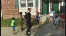IMAGE: To ease community tension, Durham officer does 'Nae Nae' with children
