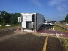 Authorities shut down northbound lanes of Interstate 95 in Johnston County Thursday morning after tractor-trailers carrying chickens and corn collided near Kenly. (Photo by John Payne)