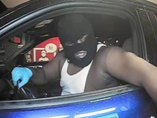 Cary police released this bank security camera image showing one of the men suspected of breaking into a home on June 16, 2016, and forcing an adult inside to go to a nearby ATM to withdraw cash.