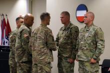 Master Sgt. Jeffrey Gassaway and Spc. Benjamin Rogers received the Soldier's Medal on June 24, 2016, for helping first responders rescue a person from a fiery car crash in October 2014. Gassaway's wife and Rogers' son also were honored.