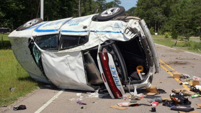 A Vass police officer suffered minor injuries on June 26, 2016, when his patrol car flipped on N.C. Highway 690 as he responded to a call. (Photo by Frank Staples)