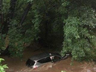 A Durham County sheriff's deputy and Durham firefighters pulled two people from a rain-swollen creek on Tuesday after their vehicle hydroplaned and swerved off the road.