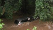 IMAGE: Durham deputy rescues woman, child from rain-swollen creek
