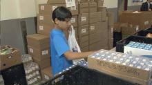 IMAGE: Volunteer efforts help, teach Raleigh boys about needy classmates