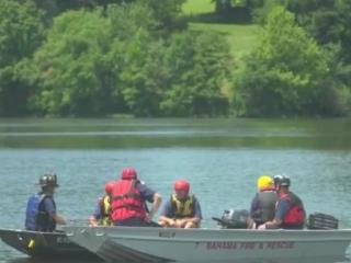 One man was rescued and another is presumed drowned Sunday after a canoe flipped at Little River Lake.