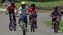 IMAGE: Hillsborough officers surprise kids with new bikes