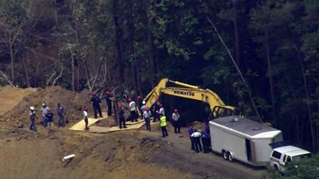 Authorities work to recover the body of an Edgecombe County man after a trench caved in on him in Rocky Mount on Aug. 1, 2016.