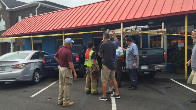 One person suffered minor injuries Friday morning when two trucks crashed into a restaurant on Raeford Road in Fayetteville. (Photo courtesy Fayetteville Observer)
