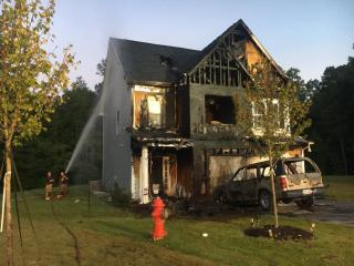 A vehicle fire early Wednesday morning in Clayton destroyed the car and the house where it was parked, forcing a pregnant woman, her child and four dogs out of the home.