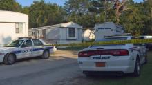 IMAGE: Neighbors believe decomposing bodies were inside Fayetteville home for 2 weeks