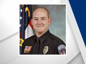 A Shelby, N.C., police officer died Monday after being shot early Saturday while looking for a suspect, the police department said. Officer Tim Brackeen was shot shortly after midnight Saturday.
