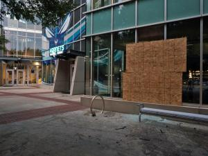 Streets appeared calm early Thursday in downtown Charlotte after a second night of violent protests over the deadly police shooting of a black man. Many businesses are cleaning up damage left behind by the clashes.