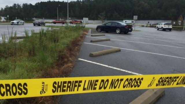 Officials: Body found near boat ramp in Harris Lake