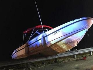 Multiple people were injured Friday night when a small boat crashed into a dam at a lake in Moore County.