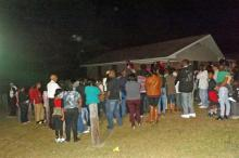 A crowd of about 200 people gathered Saturday night at a Southern Pines home to remember a 12-year-old girl who was killed, and a 3-year-old boy who was injured, in a drive-by shooting Friday.