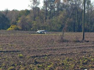 Two people on board a single-engine airplane were not hurt early Thursday when the plane crashed into a field in Greene County.