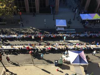 About 1,000 people sat down to a dinner table in the middle of Fayetteville Street Sunday afternoon and enjoyed a classic North Carolina meal to raise money for Hurricane Matthew flood victims.