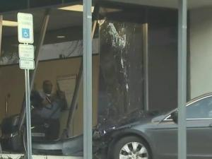 The car, driven by a man who was not identified, crashed into the Duke Raleigh Lifestyle and Disease Management Center in the 3300 block of Executive Drive.