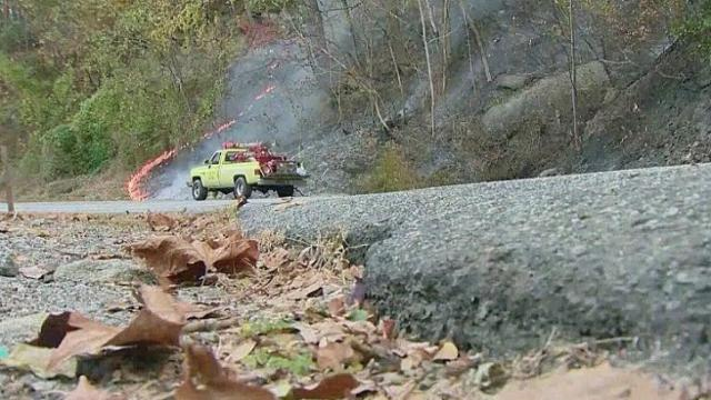 Gov. Pat McCrory issued a $10,000 reward on Thursday for information leading to the arrest of anyone responsible for wildfires burning in western North Carolina.