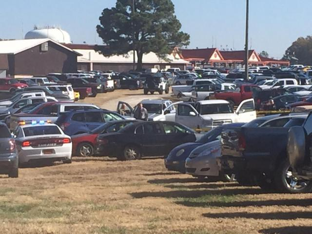 A woman was accidentally shot in the head outside a Raleigh gun show, authorities said.