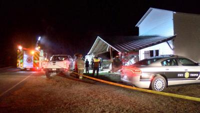 Car crashes into barn, farm equipment in Four Oaks