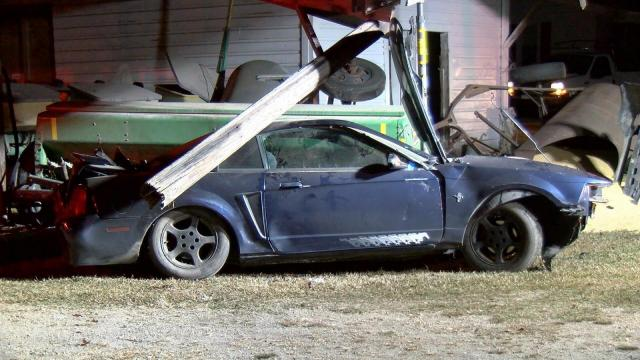 Car crashes into barn, farm equipment in Four Oaks