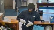 IMAGES: Fayetteville police release photos of man wanted in bank robbery