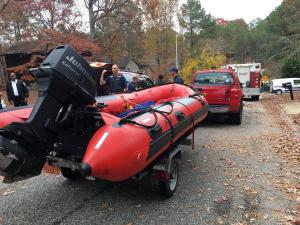 Authorities respond to McFayden Lake in Fayetteville on Nov. 29, 2016, after a PWC worker drowned when a Bobcat overturned as he was repairing an earthen dam damaged in Hurricane Matthew.