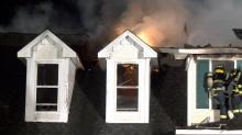 IMAGES: Officials: Large house fire blocks road in Clayton