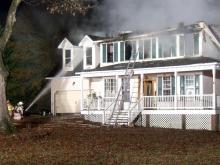 Officials: Large house fire closes road in Clayton