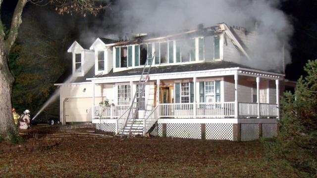 A large house fire prompted officials to temporarily close a segment of road in Clayton Monday morning.