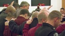IMAGE: Roxboro residents pray for unity after KKK parade